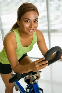 Best Exercise Bikes - Athlete Working Out on a Schwinn Indoor Cycle