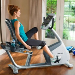 Precor Exercise Bike - Woman Exercising In Home Gym